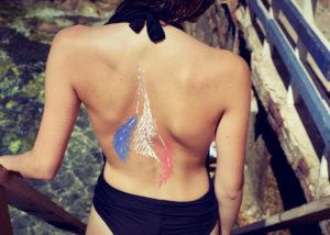 Peinture sur corps et body painting par Enkage à la plage