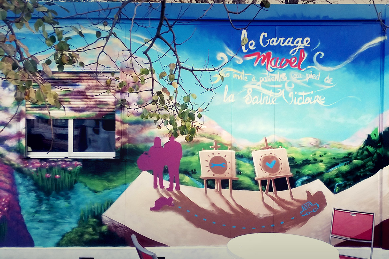 Déco mur extérieur en graffiti pour la devanture du garage Mavel par l'artiste Enkage