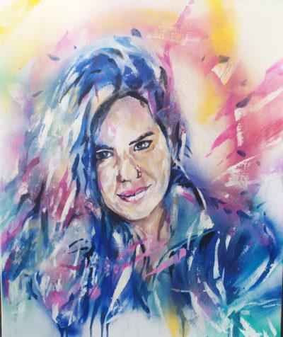Peinture de portrait street art par un artiste