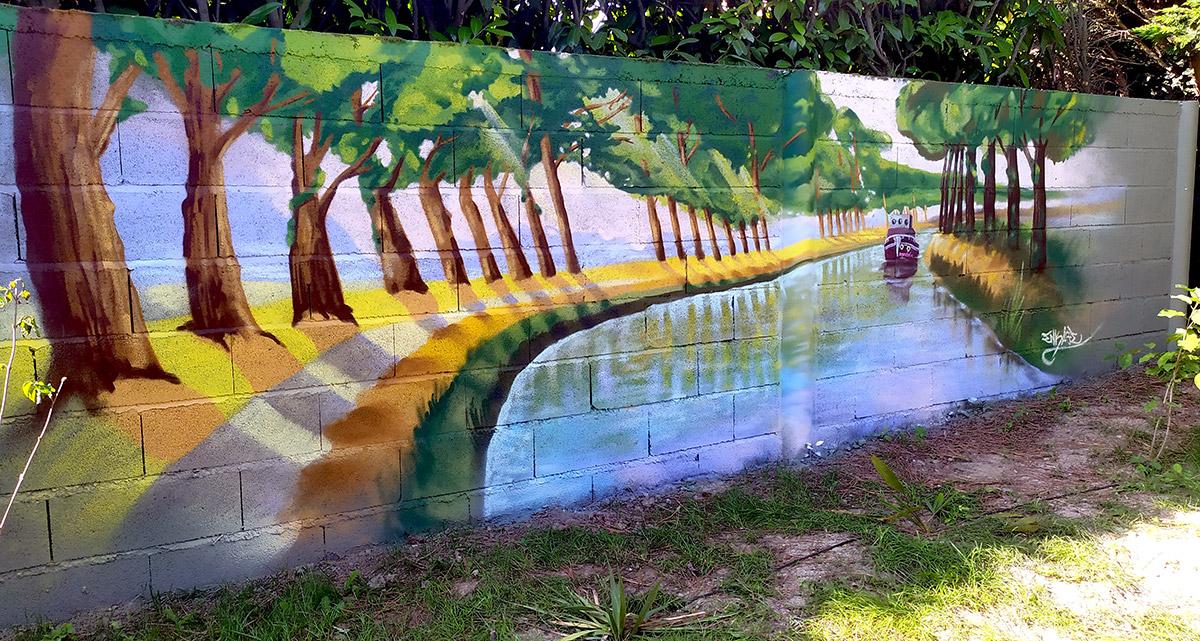 Un graffiti dans le jardin : le canal du midi chez vous par un artiste graffeur décoration : Enkage