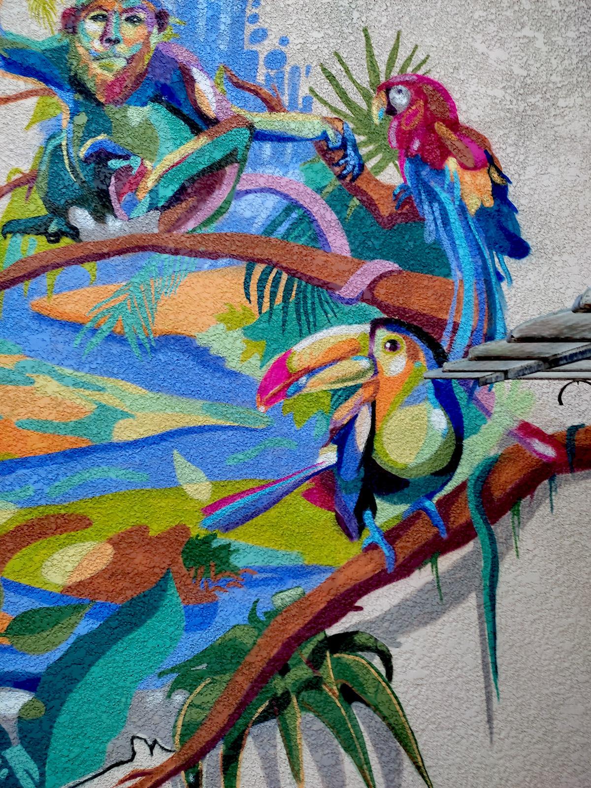 Perroquet, singe, oiseau en peinture street art fresque en France Par l'artiste Enkage
